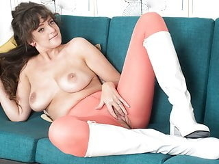 Big tits brunette Kate Anne masturbates in pantyhose boots